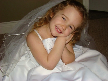 Playing dress-up in Mommy's wedding dress