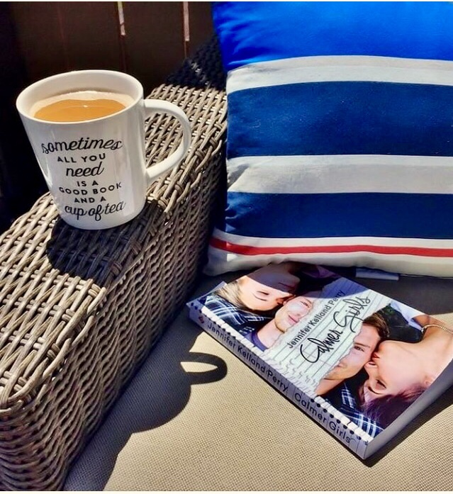 A cup of tea and a Calmer Girls book on a chair in the sun